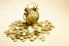 Alarm Clock and Coins Stock Photos