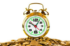 Alarm clock and coins Stock Images