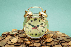 Alarm clock  on a coins Royalty Free Stock Photo