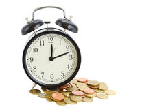 Alarm clock and coins Royalty Free Stock Image