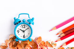 Alarm clock and color pencil Royalty Free Stock Image