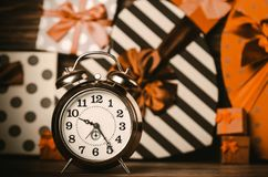 Alarm clock and colorful gifts royalty free stock photos