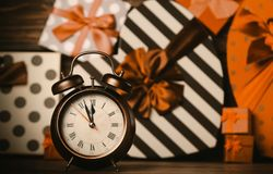 Alarm clock and colorful gifts stock photos