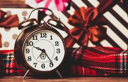 Alarm clock and colorful gifts royalty free stock images