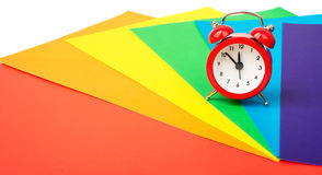 Alarm clock with colorful paper Royalty Free Stock Image
