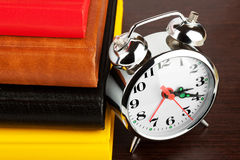 Alarm clock and colourful books Royalty Free Stock Photography