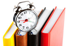 Alarm clock and colourful books Royalty Free Stock Photo
