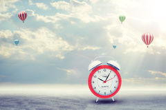 Alarm clock on concrete floor with background of Royalty Free Stock Image