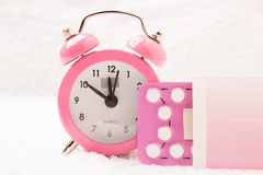 Alarm clock and contraceptive pills Stock Images