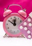 Alarm clock and contraceptive pills Stock Photos