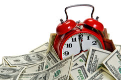 Alarm clock covered pile of money royalty free stock photo