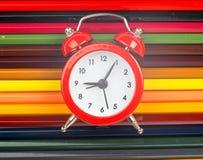 Alarm clock on crayons Royalty Free Stock Photography