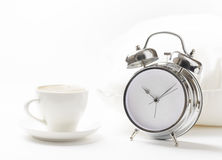 Cup of coffe and alarm clock Stock Photo