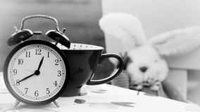 Alarm clock and cup of coffee Royalty Free Stock Photography