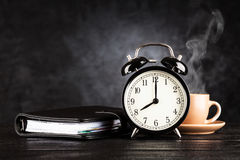 Alarm clock and a cup of coffee Stock Images