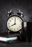 Alarm clock and a cup of coffee Royalty Free Stock Photo