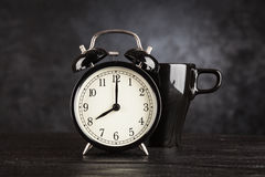 Alarm clock and a cup of coffee Royalty Free Stock Image