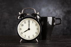 Alarm clock and a cup of coffee Stock Image