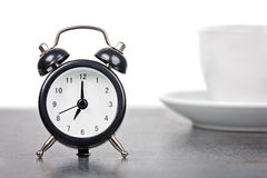 Alarm clock with cup of coffee Stock Photography