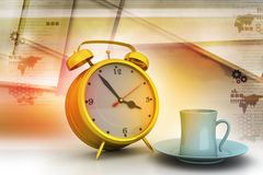 Alarm clock with cup of tea Royalty Free Stock Images