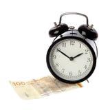 Alarm clock on Danish money Stock Photo