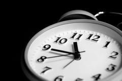 Alarm clock in the dark Stock Photo