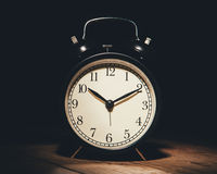 Alarm clock in the darkness Stock Images