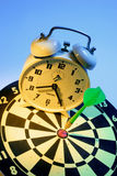 Alarm Clock and Dart Board Royalty Free Stock Photo
