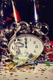 Alarm clock and decorations on table Royalty Free Stock Photography