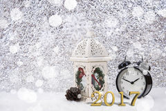 2017 alarm clock decorative on white table with snowflake. Stock Images