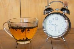 Alarm clock, delicious tea.  Royalty Free Stock Images