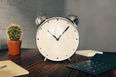 Alarm clock on desk Royalty Free Stock Photos