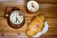 Alarm clock, a disposable cup of espresso and Royalty Free Stock Photo