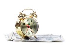 Alarm clock  for dollar banknotes Stock Image