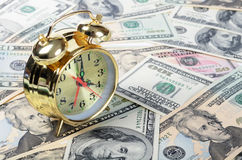 Alarm clock  for dollar banknotes Stock Image