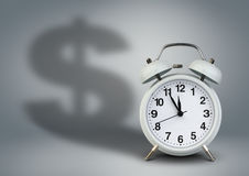 Alarm clock with dollar shadow, time is money concept Stock Photography