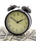 Alarm clock and dollars Royalty Free Stock Images