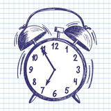Alarm clock. Doodle sketch on checkered paper background. Vector illustration Stock Photography