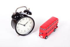 Alarm clock and double-decker bus Stock Photo