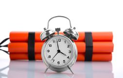 Alarm clock and dynamite Royalty Free Stock Photography