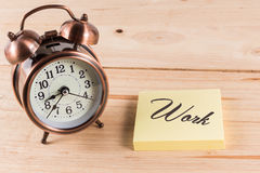 Alarm clock with empty sticky note Stock Images