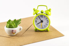 Alarm clock and envelope on white background. Alarm clock and envelope  on white background Stock Photography