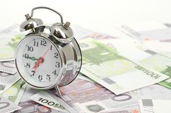 Alarm clock for euro banknotes Royalty Free Stock Image