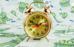 Alarm clock on a Euro Royalty Free Stock Photography