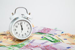 Alarm clock for euro banknotes. Real money Stock Image