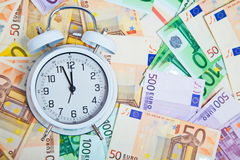 Alarm clock for euro banknotes. Real money Stock Photography