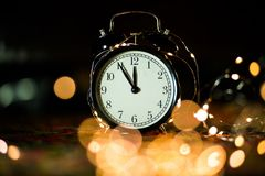 Alarm clock in anticipation of the holiday stock photos