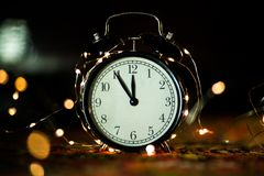 Alarm clock in anticipation of the holiday royalty free stock images