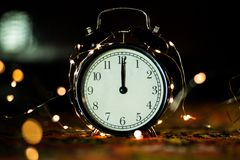 Alarm clock in anticipation of the holiday royalty free stock photos