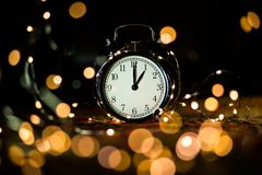 Alarm clock in anticipation of the holiday stock images
